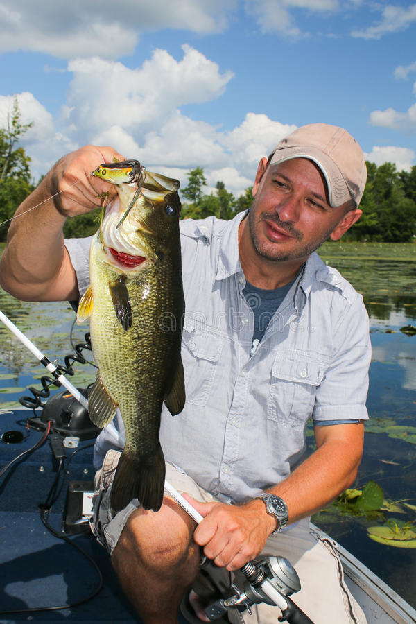 Man Fishing for Largemouth Bass stock images