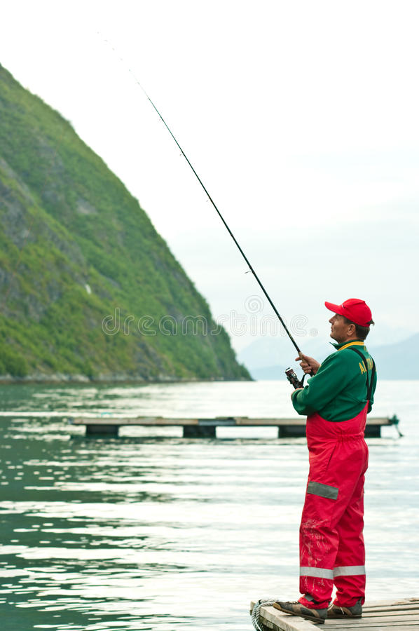 Man fishing in Norwegian fjord stock photos