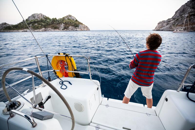 Man fishing in the sea stock photo