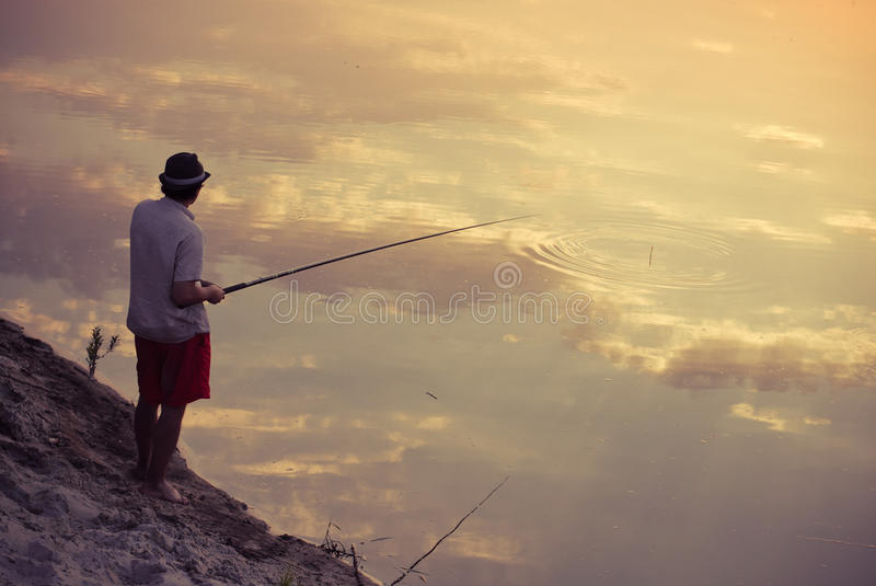Download Man Fishing In The Sky Reflection Stock Images - Image: 20506714