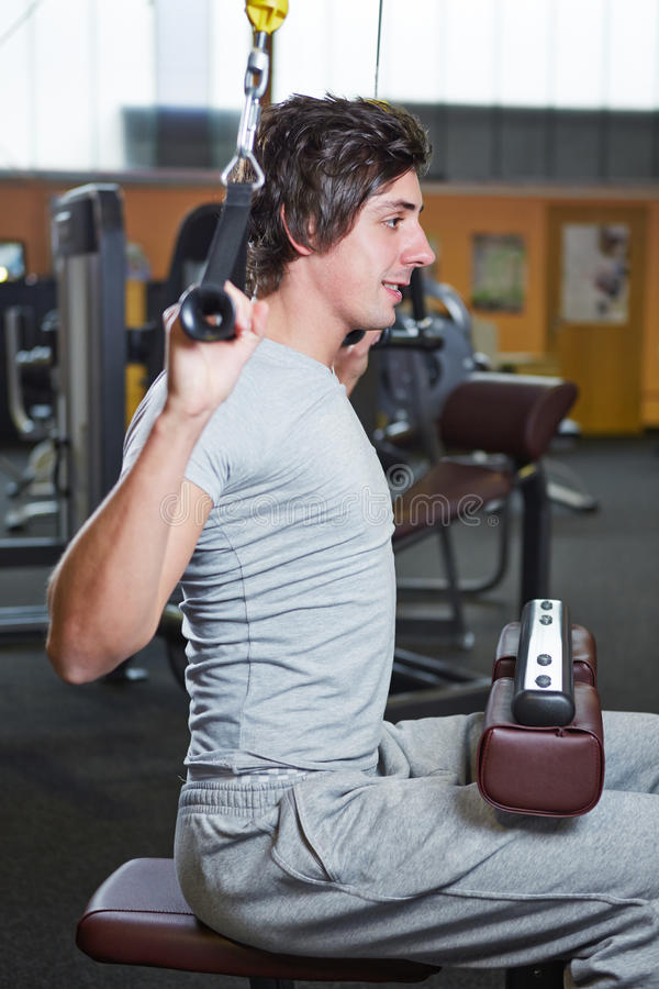 Download Man In Fitness Center On Pull-up Stock Image - Image: 27786631