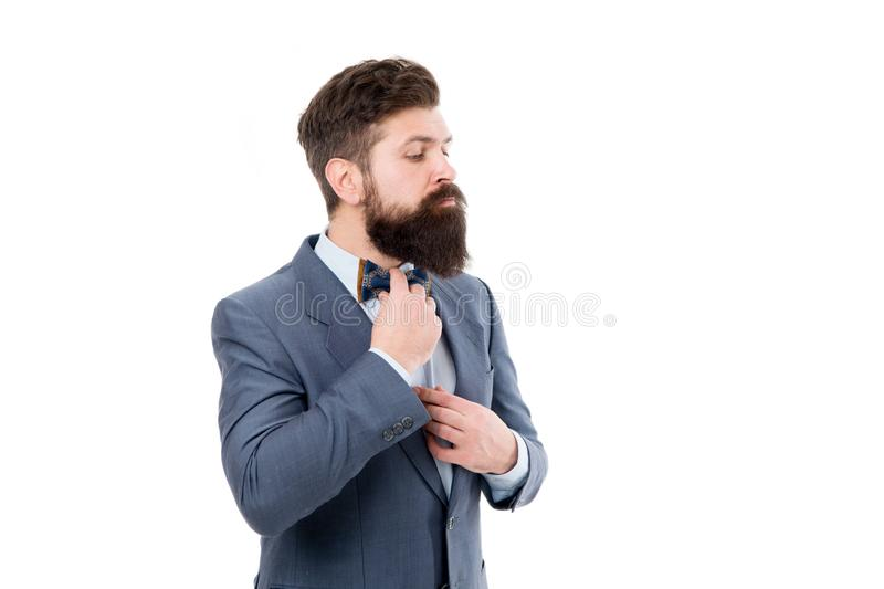 Man fix bow tie. Brutal businessman grooming. Mature man with beard in jacket isolated on white. formal fashion for. Bearded hipster. Male boss wear bow tie stock photo