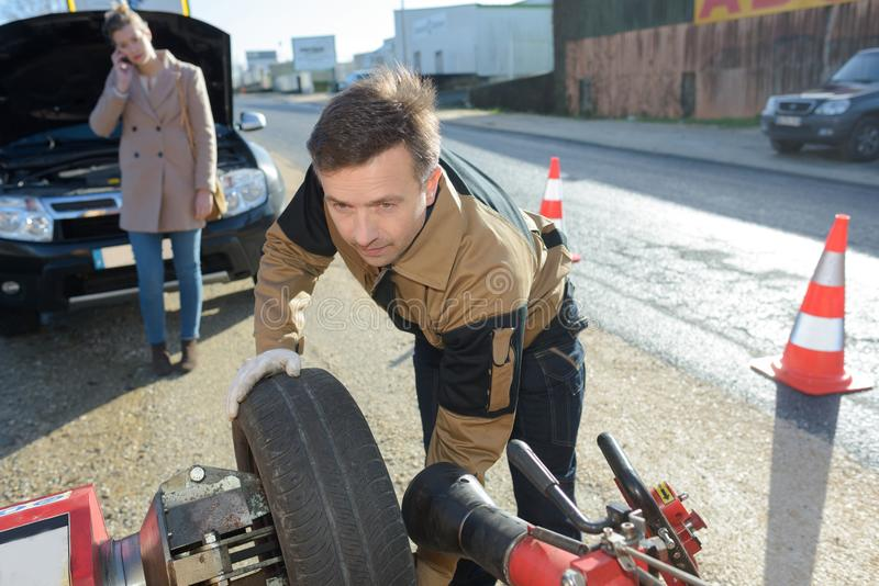 Man fixing car problem after vehicle breakdown stock photography