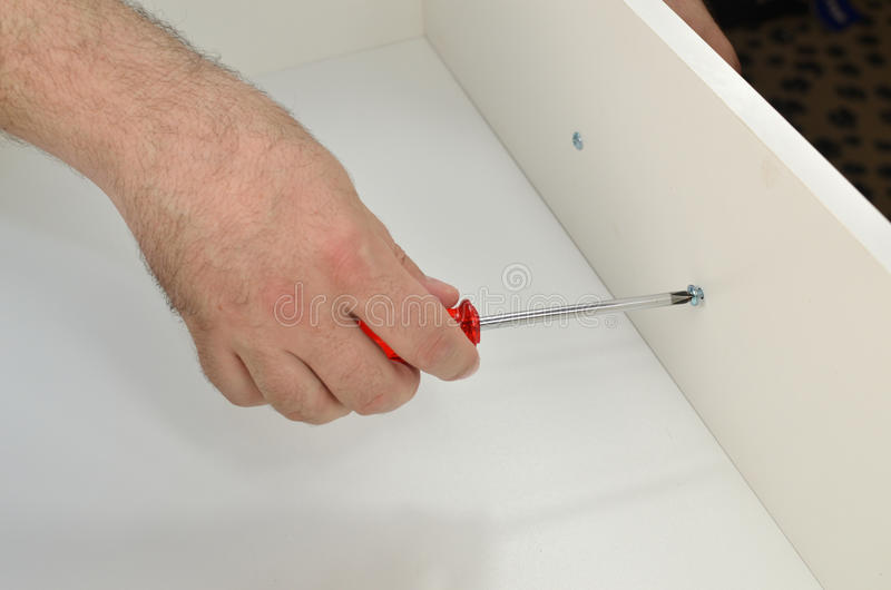 Man is Fixing a Drawer Pull stock photos