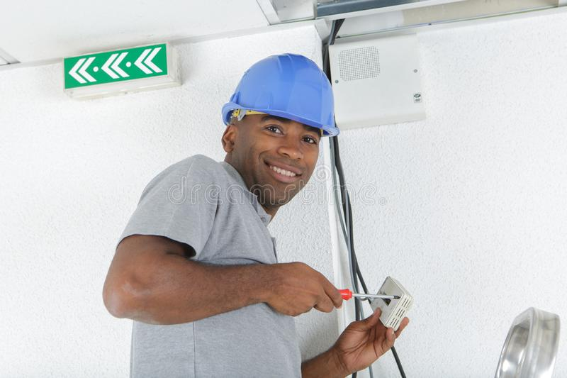 Man fixing electrical wire royalty free stock photo