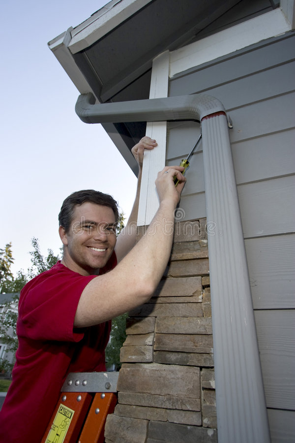 Man Fixing House stock photos