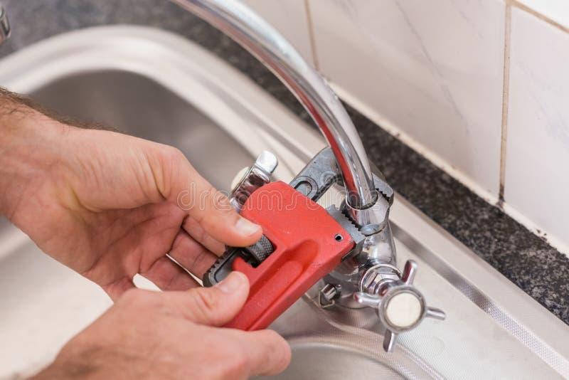Man fixing tap with tool stock image. Image of plumbing - 47014451