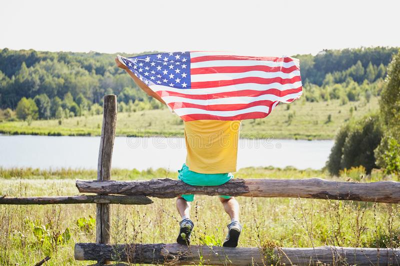 Man with the flag of the United States of America stock photos