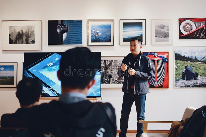 Man Beside Flat Screen Television With Photos Background royalty free stock photo