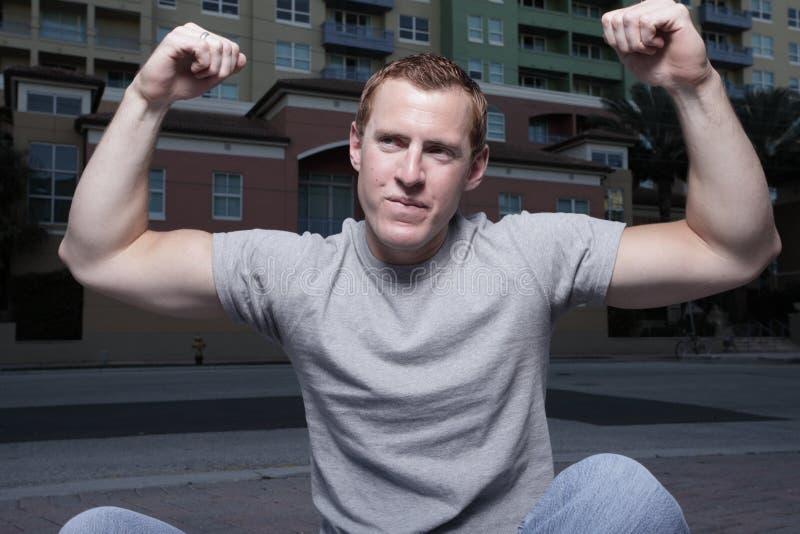 Man flexing royalty free stock photos