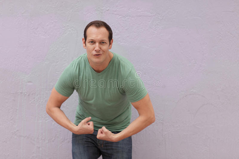 Man flexing royalty free stock photography
