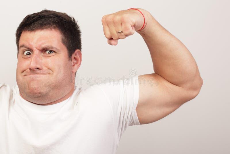 Man flexing his arm stock photo