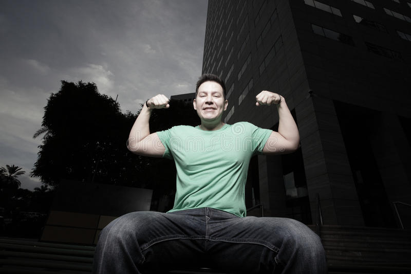 Man flexing his arms stock images
