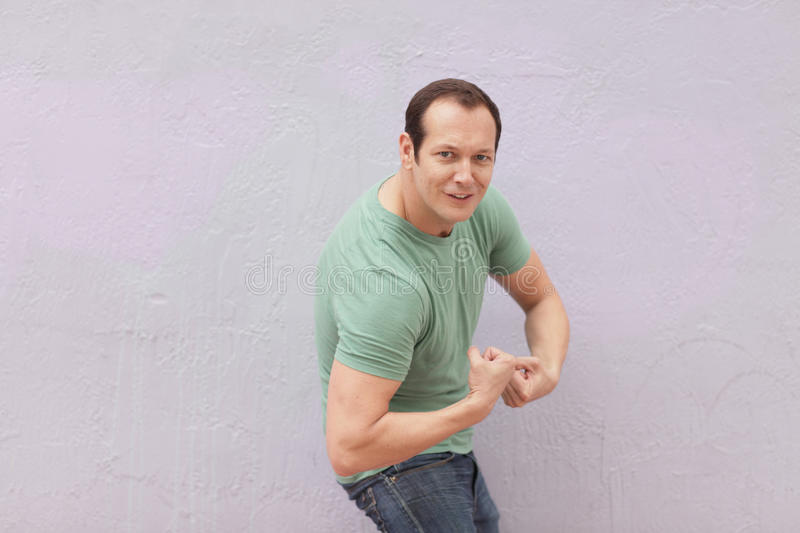 Download Man flexing his muscles stock photo. Image of flexing - 19261998