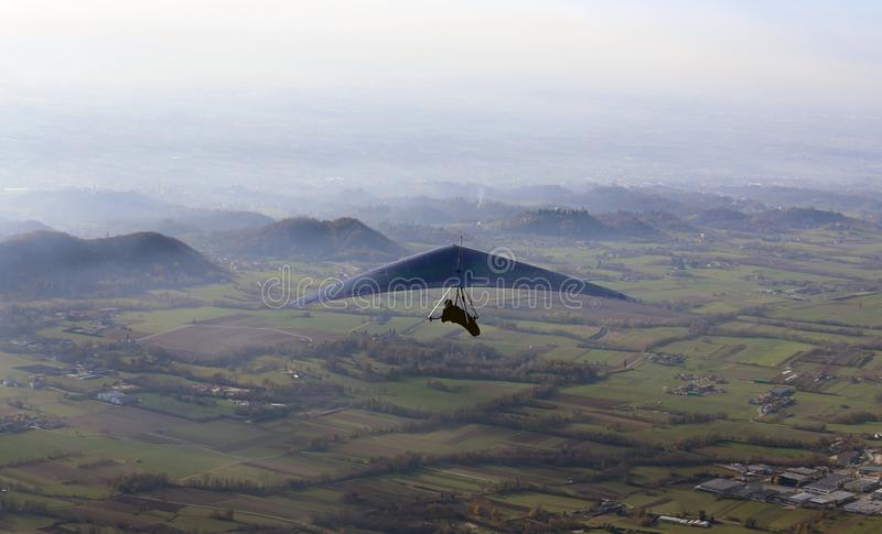 Man flies with his hang gliding royalty free stock image