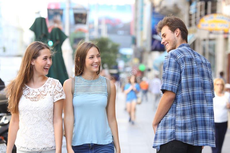 Man flirting with tho happy women stock image