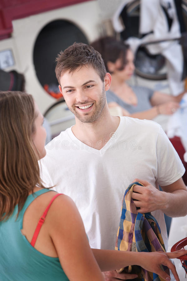 Man Flirts In The Laundromat stock photos