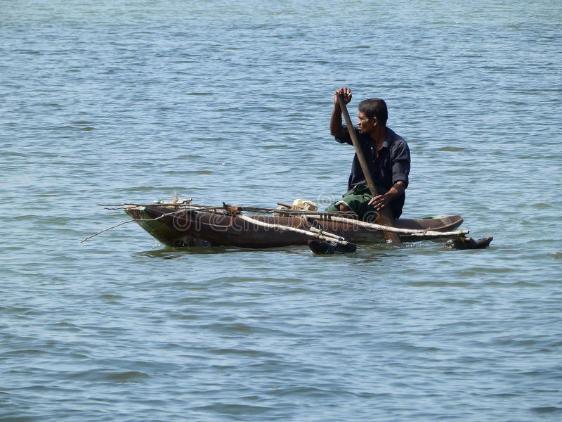 Man floating in the river by boat, Sri Lanka stock photos