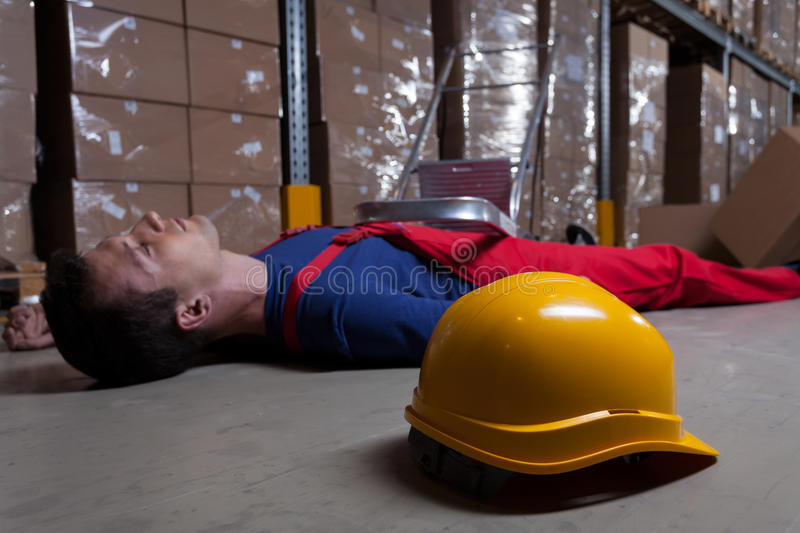 Man on the floor in factory stock image