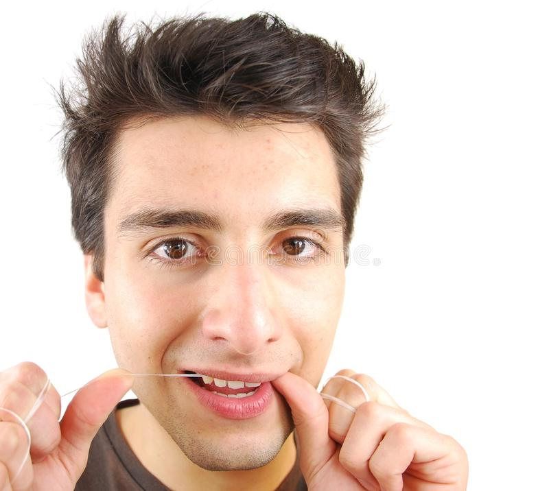 Man flossing his teeth stock photo