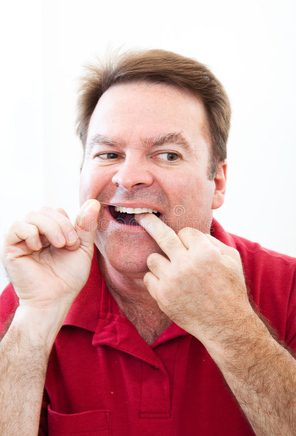 Man Flossing Teeth In The Mirror Royalty Free Stock Images