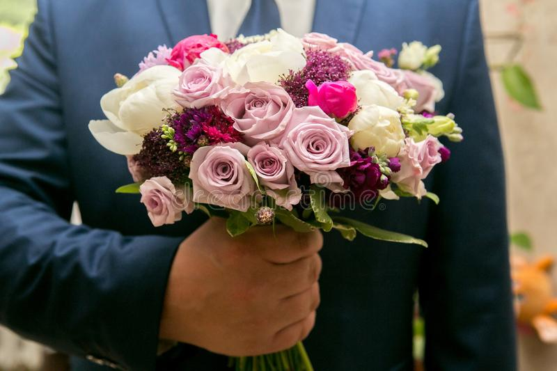 Man with flower bouquet stock image. Image of garden - 108096015