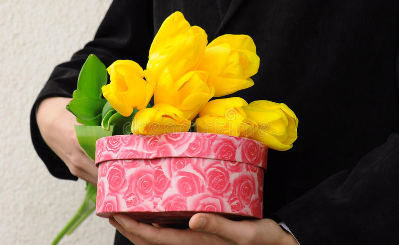 Man With Flowers And Gift Box stock photos