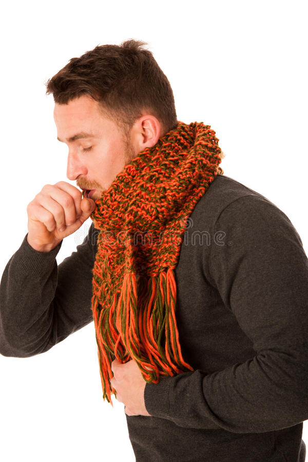Man with flu and fever wrapped in scarf holding cup of healing t. Ea and coughing isolated over white stock photography