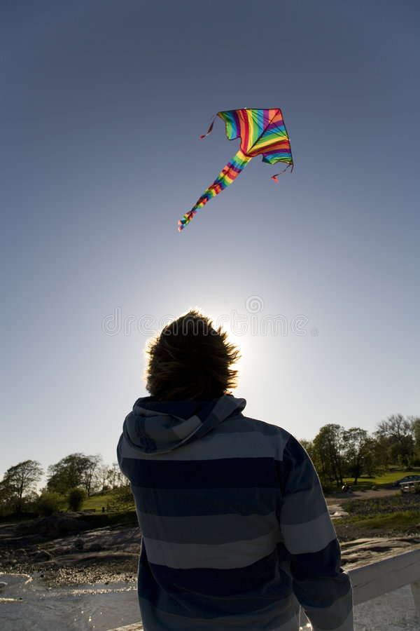 Man flying a kite stock photography