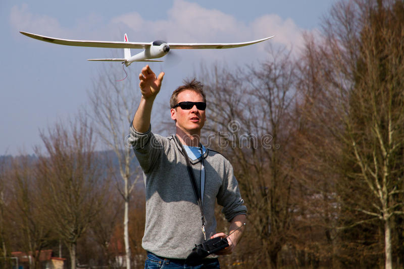 Download A man flying a model plane stock image. Image of trees - 24042989