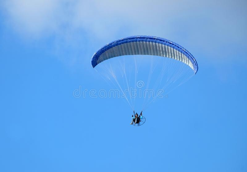 Man is flying with a paraglider stock images
