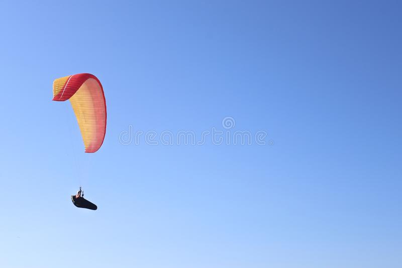A man is flying on a paraglider in the sky royalty free stock photos