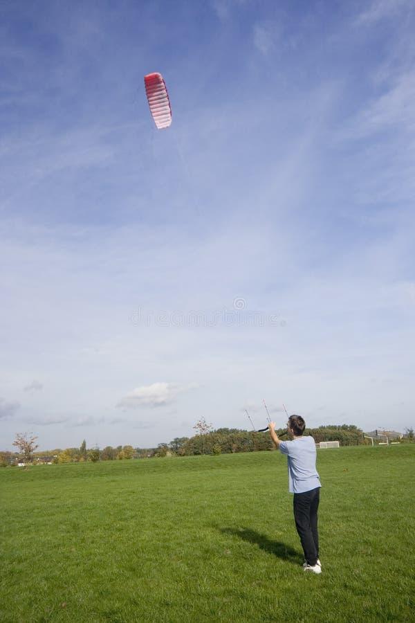 Man flying a power kite stock photo