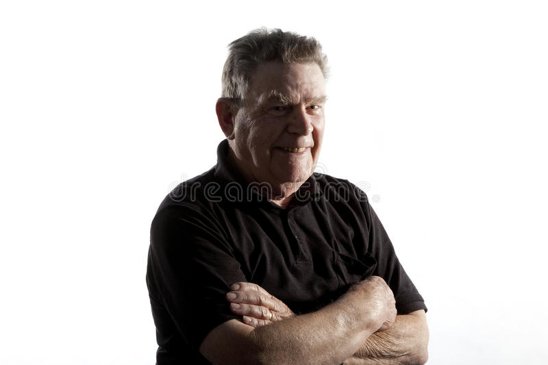Man with folded arms. Old man posing with folded arms royalty free stock photo