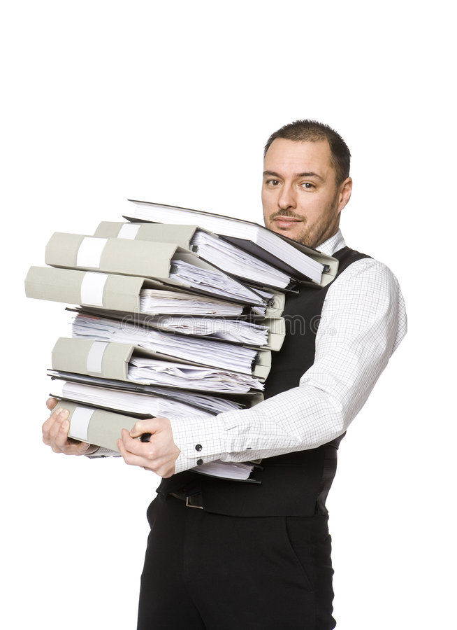 Man with folders. Man carrying a pile of binders stock images