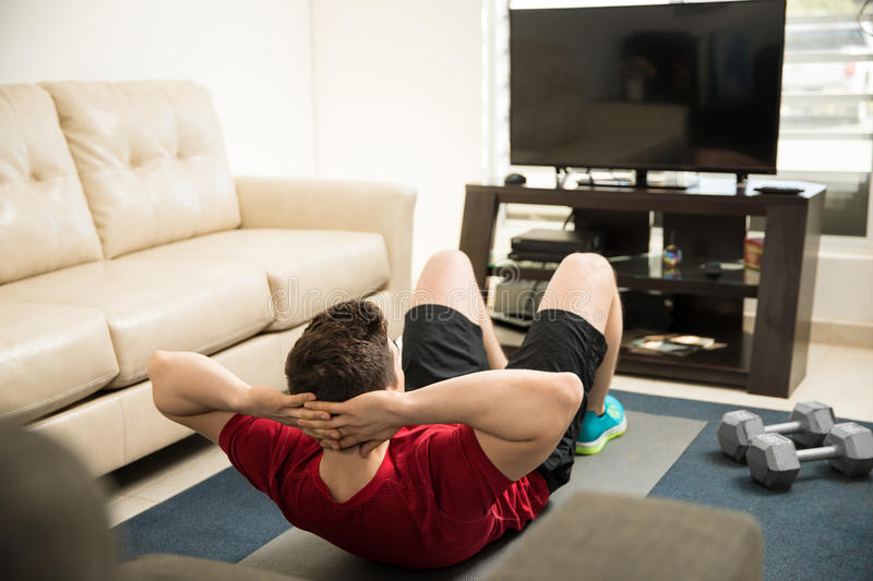 Man Following An Exercise Routine On TV Stock Image - Image of ...