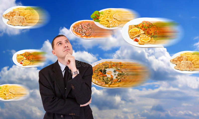 Man and food. Bussines man look the flying fast food stock photo