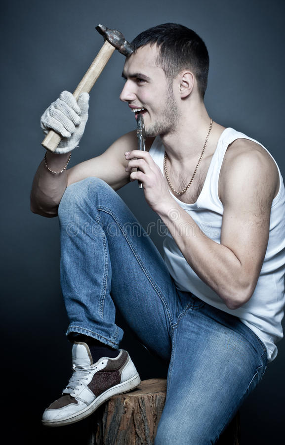 Download Man Fooling Around With Instruments,monkey-like Stock Photography - Image: 24494612