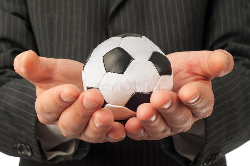 Man with football. Man holding small football over black suit background stock photos