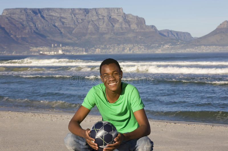 Download Man With Football On Table Mountain Beach Stock Image - Image: 33903203