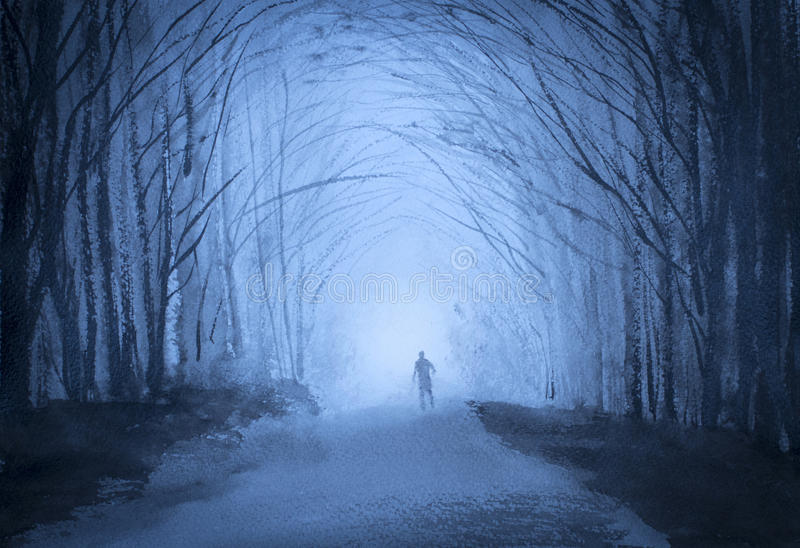 Man in a forest at dusk. And fog stock photography