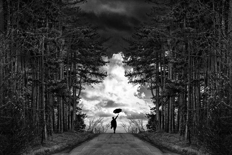 Man in the forest road. With umbrella stock photos
