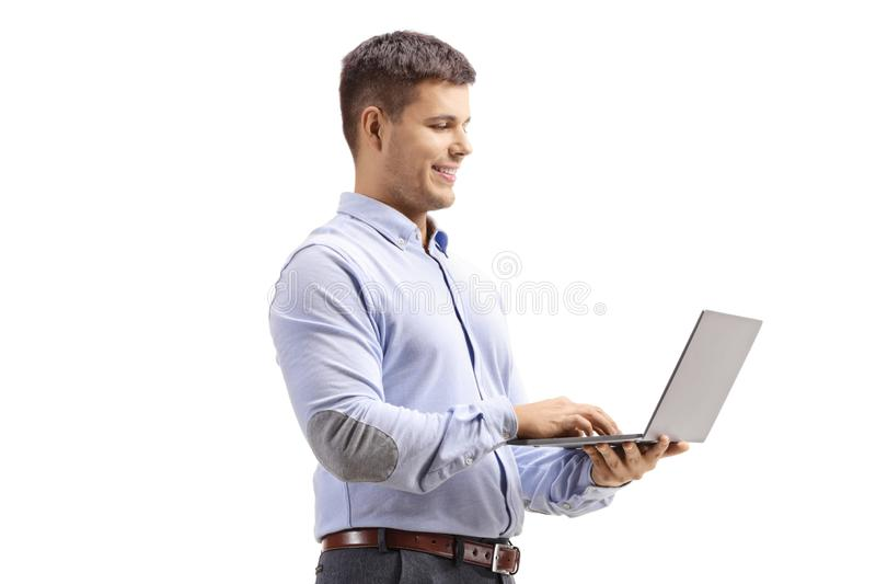 Man in formal clothes holding a laptop computer royalty free stock photos