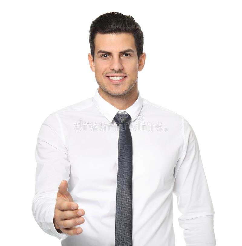 Man in formal clothes reaching out for handshake. On white background stock photo