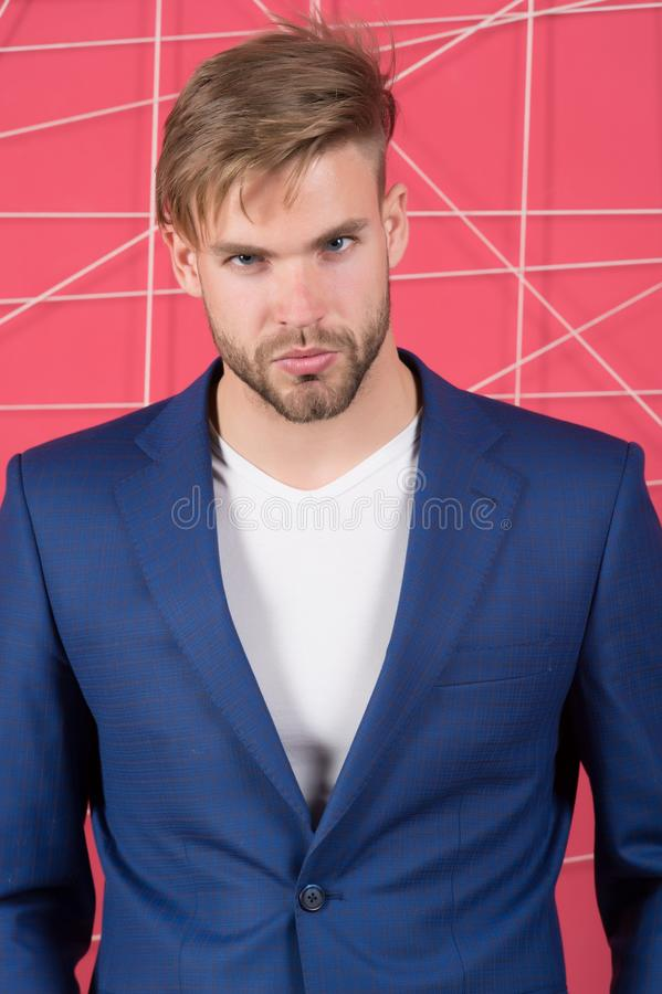 Man in formal suit jacket and tshirt, fashion. Businessman with bearded face, hair, haircut. Mens fashion, style and dress code. B royalty free stock photo