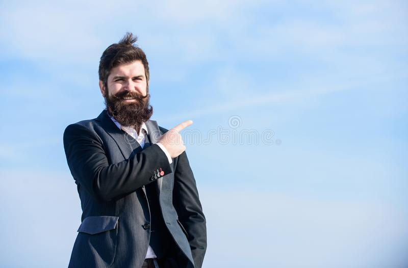 Man formal suit manager looking direction. Developing business direction. Businessman bearded face sky background stock image