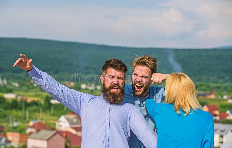 Man found girlfriend cheating him with bearded macho. Jealous and violence concept. Boyfriend full of jealous and. Aggression beating, fight with lover. Man royalty free stock image