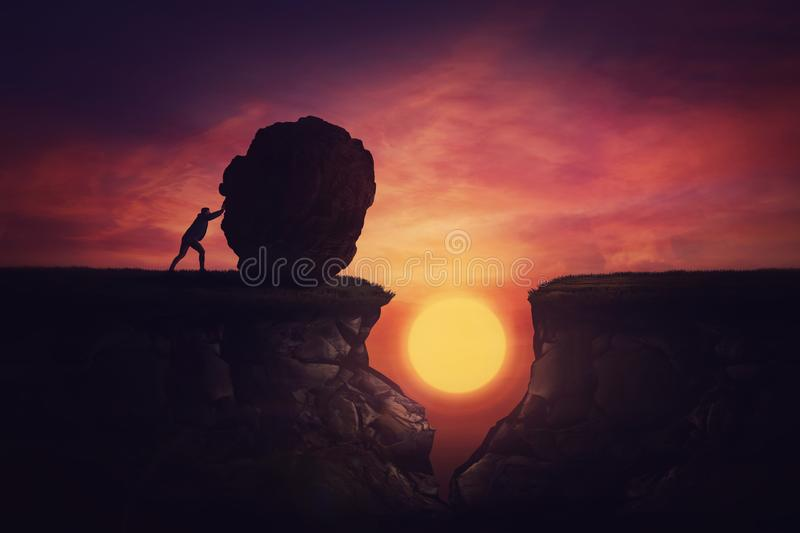 Man found solution in difficult situation, pushing a huge boulder to fill the gap obstacle. Using rock, cover the abyss hole and. Reach other side of the cliff stock photography