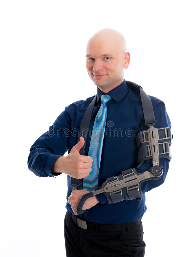 Man with fractured arm and thumb up stock photo