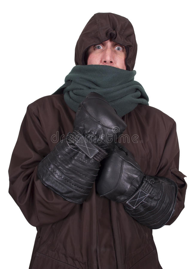 Man Freezing Cold, Winter Bundled up Coat Isolated. Man is freezing in the cold while bundled up in his winter time coat and hood while trying to keep warm royalty free stock photos